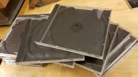 12 CD Album cases, scratched
